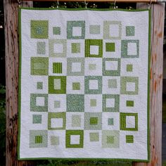 I really like this liberated take on square-within-a-square quilts with alternating colored/white-bordered blocks! It doesn't hurt that it's green, either, as I'm on a big green kick lately.  Its Easy Being Green Squares Modern Quilt. $78.00, via Etsy.