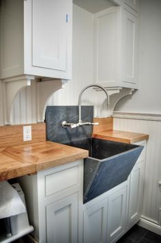 soapstone sink in a laundry room = love.  by Gulf Shore Design