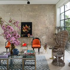 Modern living room with orange armchairs // living room
