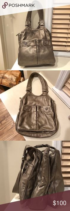 """Marc By Marc Jacobs Leather Shoulder Bag Pewter MBMJ leather shoulder bag w/ silver features. This bag is amazing! 3 HUGE POCKETS, middle pocket zips closed, 2 outer lock pockets. Inner zip pock and 2 small pockets. Leather is super soft. No stains and in impeccable, excellent condition. Can increase width and hold a ton.   12""""H x 13""""W Straps - 11"""" Marc By Marc Jacobs Bags Shoulder Bags"""