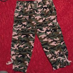 Camo capris So Cute😍😍😍these camo capris are a size S fitting like a 3, the colors are green, brown, black, and pink. These have two front, two rear and a side cargo pocket as shown. They gather and tie at the bottom. Zoey Beth Jeans