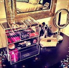 Clear Acrylic Makeup Storage. Can be found at the Container Store. - Looks pretty spacious, I like it