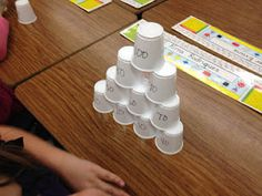 Fun way to practice counting by tens - 10 plastic cups numbered 10-100. Order, stack, race, knock 'em down and do it again!