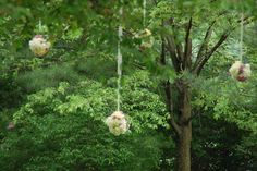 Flower pomanders hanging from trees