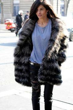 big fur, leather pants, and a tshirt.