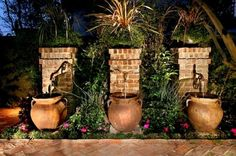 Add to Ideabookby AMS Landscape Design Studios, Inc. by AMS Landscape Design Studios, Inc.  Reduce, reuse ... This charming set of water fountains appears to be fed by runoff from a slope. Once captured, of course, the water can be reused
