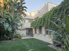 Now on the market: Cultural Historic Monument Lloyd Wright's Henry Bollman Residence. Wright's vision is expressed through a building system utilizing precast concrete blocks to augment standard construction techniques. Free Hotel, Wood Exterior Door, Hollywood Homes, Building Systems, Pinterest Photos, Frank Lloyd Wright, Architecture, Luxury Homes, Mansions