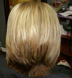 Cute slightly inverted cut with lots of layers. Subtle blonde highlights with a few lowlights throughout the top and a base.