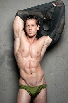 Model Joshua Michael Brickman wearing an army green speedo