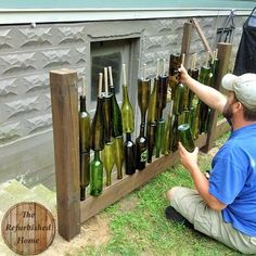 Make Your Repurposed Wine Bottle Fence - 1001 Gardens Make Your Repurposed Wine Bottle Fence Fences Wine Craft, Wine Bottle Crafts, Bottle Art, Recycled Bottles, Recycled Glass, Recycle Wine Bottles, Backyard Projects, Garden Projects, Wine Bottle Fence