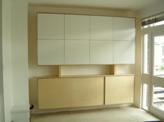 Wall mounted storage cabinet - Stonermakes The piece is constructed in Birch plywood. Doors laminated in a white Formica. the remainder is sprayed with a clear laquer.