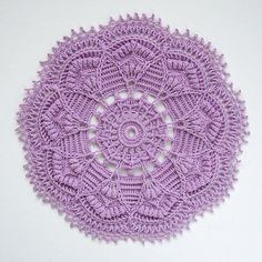 Textured crochet doily with intricate details.   This pattern is written only instructions with photos for reference to some more complicated rounds. Pattern uses U.S./American terminology, is worked in rounds and consists of 31 rounds.  Pattern will be available for download in PDF format after th