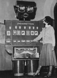 """""""Robot"""" cigarette vending machine, Berlin, Germany, 1955 - The machine thanked customers on payment for the cigarettes, and at the same time gave road safety advice. Road accident scenes were projected in the robot's eyes."""