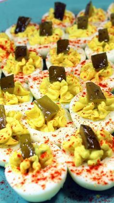 "Deviled Eggs - PERFECT Mom's ""Old School"" Recipe  It's just hard to imagine any big gathering, PotLuck or pace a plate meal without these ""Old School"" recipe Just Like MOM used to make (or maybe Grandma).  Rich and creamy egg yolks fill the center and yes, there is an old school secret that makes these extra sweet. These are the eggs June Cleaver took for a Church Potlucks and still the best!  I even cracked the secret to getting eggs peeled easy and perfect... read on!"