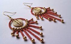 Aztec Medallion Chandelier Earring. $32.00, via Etsy.