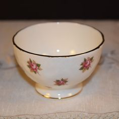 Check out this item in my Etsy shop https://www.etsy.com/listing/253670021/aynsley-pink-roses-sugar-bowl-vintage