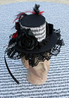 Hand-made from scratch: a Gothic Lolita mini-top hat--completely constructed from scratch (cardboard, cloth, lace, faux flowers, ribbon and glues). We found a pattern on Deviant Art. However, my daughter didn't like the way I centered the flowers, so