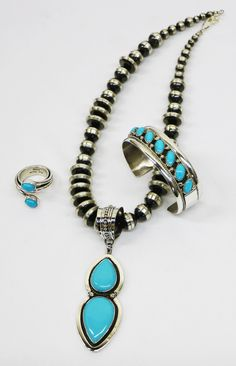 Two stone Turquoise pendant by Michael Calladitto, ring by Mark Yazzie. Row cuff bracelet in traditional Diné style.   #Turquoise #HandmadeJewelry #MarkYazzie #MichaelCalladitto #NavajoPearls