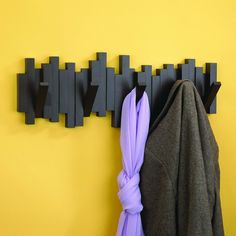Sticks Wall-Mount Rack with Five Hooks / The Sticks Wall-Mount Rack with five hooks was created by designer Luciano Lorenzatti for Umbra.  http://thegadgetflow.com/portfolio/sticks-wall-mount-rack-five-hooks/