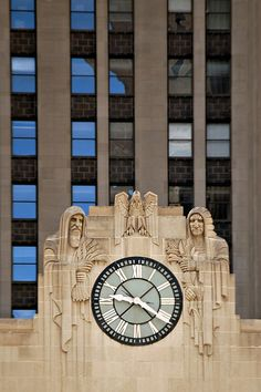 """Chicago Board of Trade. """"The clock is 13' in diameter. On each side are hooded figures; on the left is a Native American holding corn, on the right is an Egyptian holding grain."""""""