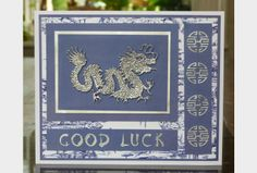 handmade card from Crafting.co.uk.... Asian them ... Silver embossed dragon and good luck coins ...