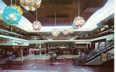 Marion Shopping Centre in 1974 with the escalators to the Quarterdeck and John Martin's Department StorePhoto from Glen H  Flickr Photostream.