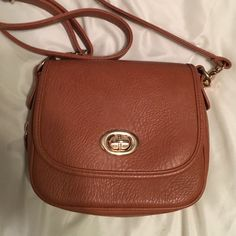 Francesca's crossbody Used only a couple times. In perfect condition! Zipper detail on the bottom opens but is not a pocket. Zipper pocket on inside. Straps are adjustable and can come off. Not real leather. Francesca's Collections Bags Crossbody Bags