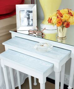 Paint old wooden tables white and cover one with cut mirror