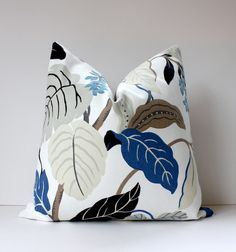 pillow cover in a bold floral print. (similar to a Josef Frank pattern) The fabric features shades of black, wedgewood blue, cobalt blue, grays and taupe against an off-white background.Patterned fabric is on both sides of 20 inch pillow.