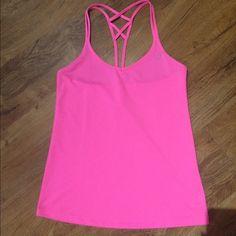 Pink Lorna Jane Tank Bright pink staph tank. Like new. Moisture wicking. Reflective lettering on back Lorna Jane Tops Tank Tops