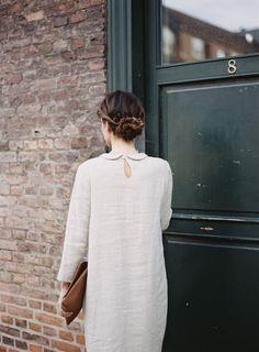 I like how simplistic her hair is, yet elegant.