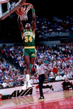 Xavier McDaniel of the Seattle Supersonics dunks against the Portland Trailblazers circa 1990 at the Veterans Memorial Coliseum in Portland Oregon...