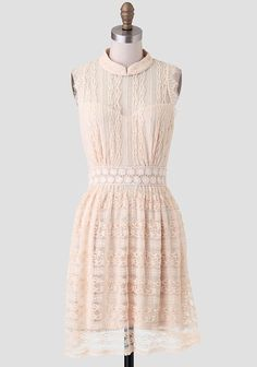 Crafted in beige floral lace, this charming dress features a daisy crochet waistband and a smocked neckline. Finished with a cutout back and sheer sweetheart neckline, this dress is perfect for a...