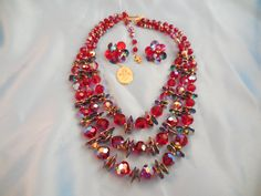 Extra Special and Beautiful Red Beaded Vendome Necklace and Earrings.  This is a masterpiece with original tags.  It was also featured in a 1962 advertisement…a very early use of the nylon cord!