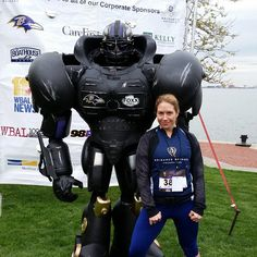 Our Group Fitness Director Devon Dohony posing with the Fox Sports Ravens robot!  Who looks tougher? lol
