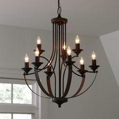 Features:  -Made of steel.  -Requires nine 60-watt bulbs (not included).  Product Type: -Candle-Style chandelier.  Material: -Metal.  Number of Lights: -9.  Bulb Type: -Incandescent.  Finish: -Bronze;