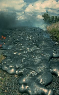 Pahoehoe is the Hawaiian word for a ropy, wrinkled-looking lava flow. The smooth surface makes a sharp contrast to blocky aaflows, Hawaiis other common lava flow type. Often, a single lava flow can switch back and forth between pahoehoe and aa as conditions such as slope steepness and loss of gas and heat change.