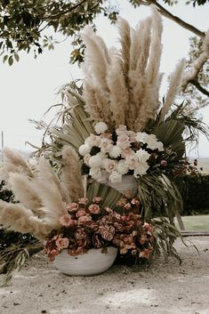 Pastel and metallic flowers with pampas grass.
