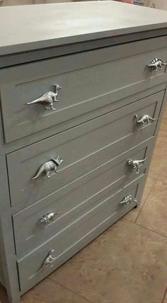 These are plastic spray painted dinosaurs that have been screwed on instead of knobs.
