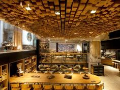 The Starbucks Amsterdam Rembrandtplein is Dynamically Designed #wooden #architecture trendhunter.com