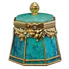 Bolin Art Nouveau Gold Mounted Amazonite Box.  A SUPERB gold mounted amazonite small box by the firm of Bolin, jeweler of the Imperial Court, workmaster Ivan Antonovich Flink. The body is carved from a single piece of amazonite and applied with stylized finely chased gold trees in Art Nouveau taste. The gold trees are set with tiny rubies and rose-cut diamonds.