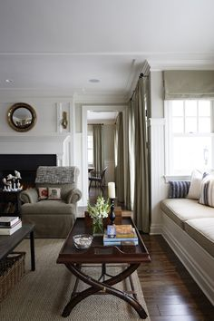 Philip Mitchell Designs - neutral living room // window seat in Tessuti Uno fabric // area rug by Elite