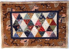 Made with beautiful reproduction fabrics. Cute little quilt.