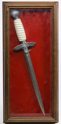 Lot 525: World War II German Replica Luftwaffe Dagger in Case; c.1960, post war dagger with blade and wrapped handle; authentic eagle emblem and round hilt; housed in small display case