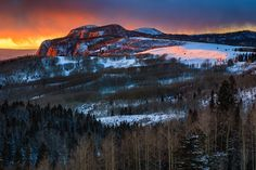 A winter sunset on the snow-covered Brazos Cliffs near Chama, New Mexico.  Adam Schallau Photography
