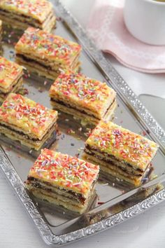 Romanian Harlequin cake – tiny layered cake squares with tangy jam, a perfect recipe for the Holiday season. #whereismyspoon #romanianharlequincake #harlequincake #romaniancake #romanianlayeredcake #romaniansweets Plum Jam, Chocolate Sprinkles, Tangier, Vanilla Sugar, Cheesecakes, Casserole Dishes, Tray Bakes, Amazing Cakes, Sour Cream