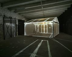 Installation 'insideout' invited the viewers to experience a storm within a greenhouse illuminated by bright projections.