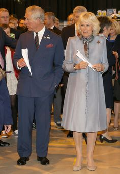 Camilla, Duchess of Cornwall and Prince Charles, Prince of Wales throw paper aeroplanes with the Prime Minister of Canada Stephen Harper at Stevenson Campus Air Hanger on May 21, 2014 in Winnipeg, Canada.