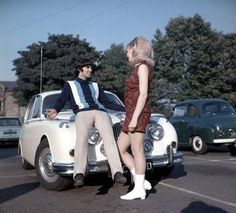 Manchester United footballer George Best poses on the bonnet of his car with Miss UK girlfriend Jennifer Lowe - October Manchester United Legends, Bobby Charlton, Transfer Rumours, E Type, Liverpool Fc, Up Girl, Football Soccer, The Guardian, Georgia