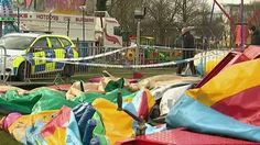 Two people were arrested on suspicion of manslaughter after a 7-year-old girl in Britain died Saturday when the bouncy castle she was playing in was swept away by a strong gust of wind, Sky News reported.
